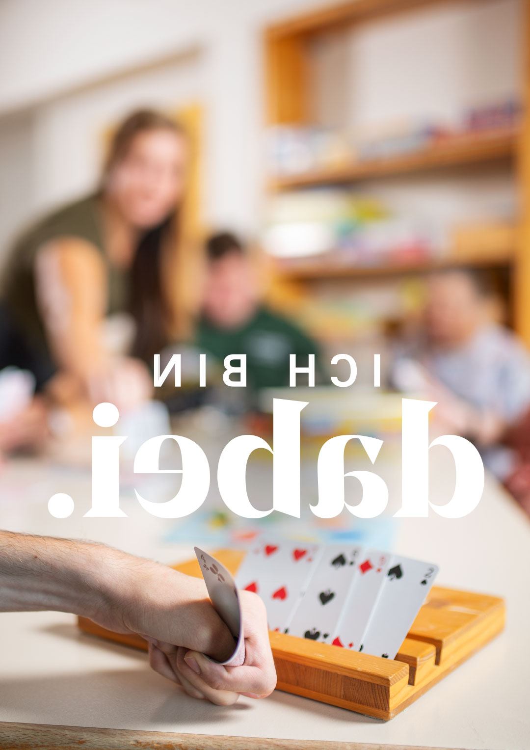 djw-lebenshilfe-hoch-sujet-kartenspielen-teaser